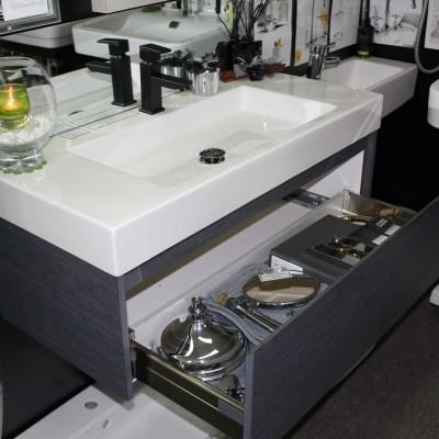 custom vanity with open drawers