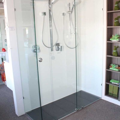 opto frameless shower screen with two shower heads